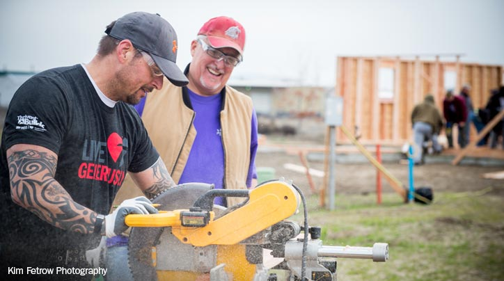 Volunteers from multiple churches join forces to build two homes.