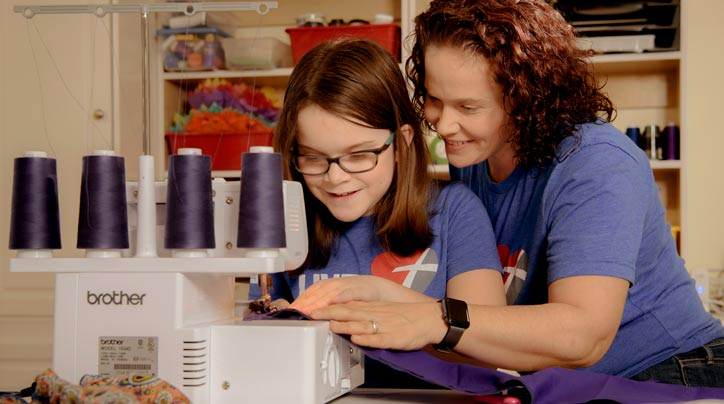 Fourth-grader inspired to sew scarves to raise money for Relay for Life.