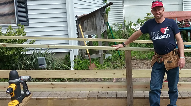 Larry Burton standing in front of a ramp he built with the Iroquois County Ramp Builders