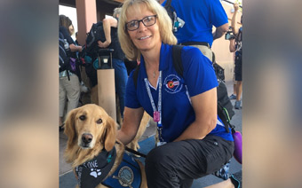 Golden retriever K-9 Comfort Dog Cubby and Thrivent member Bonnie Fear